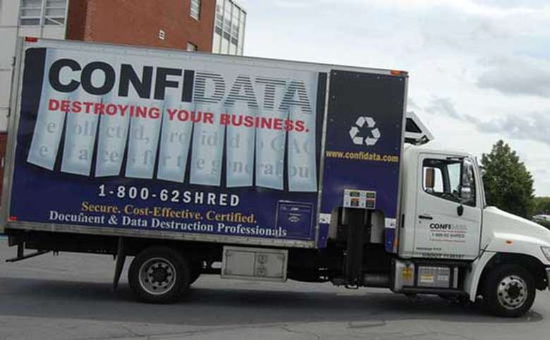 a confidata truck with large logo and the words destroying your business