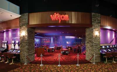 entrance to vapor night club with velvet ropes in front of it