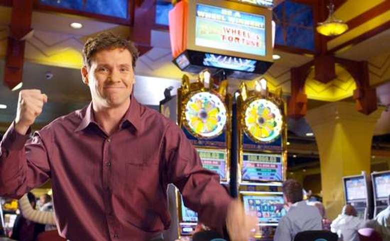 man celebrating winning in a casino