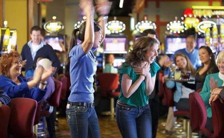 women celebrating a win in the casino