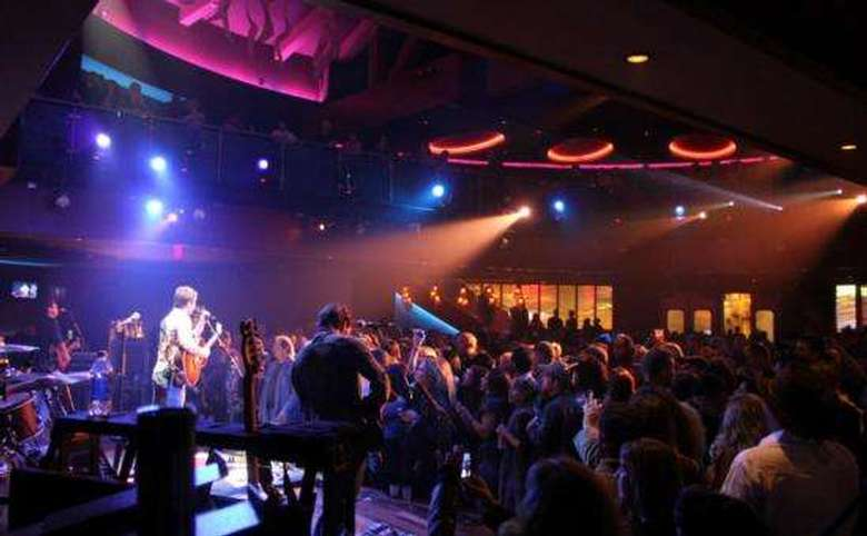 band performing on stage while a crowd watches at vapor