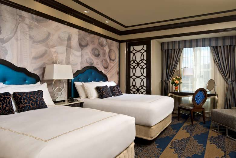 upscale hotel room with two beds