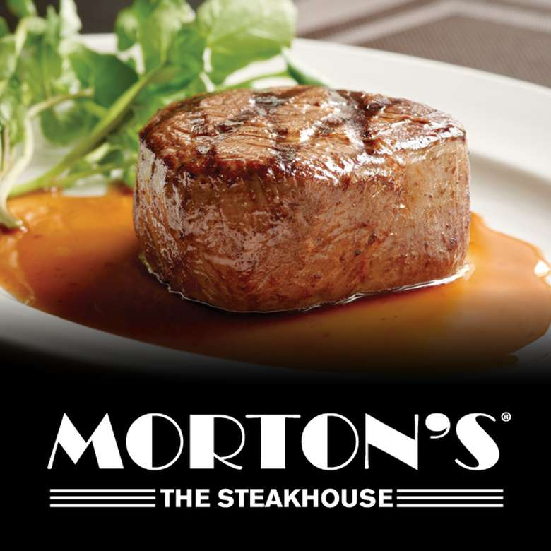 a grilled filet with a sauce and morton's logo below