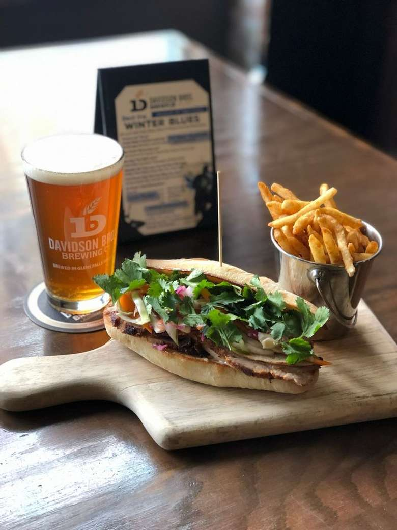 fries, sandwich, and a glass of beer