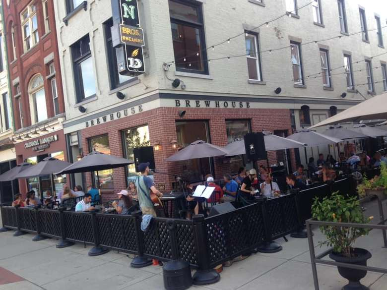 people on patio outside a restaurant