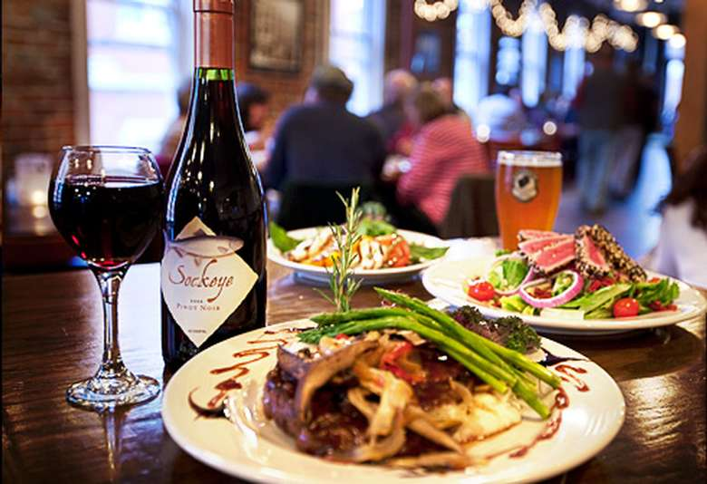beer, wine, and plates of food on a table