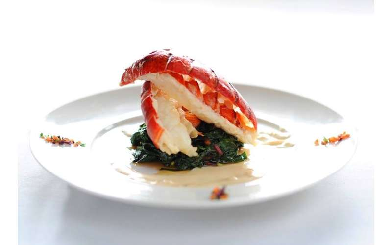 lobster Betty -- poached lobster tail over braised greens