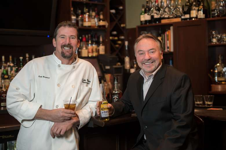 owners of Lake Ridge Restaurant  at bar