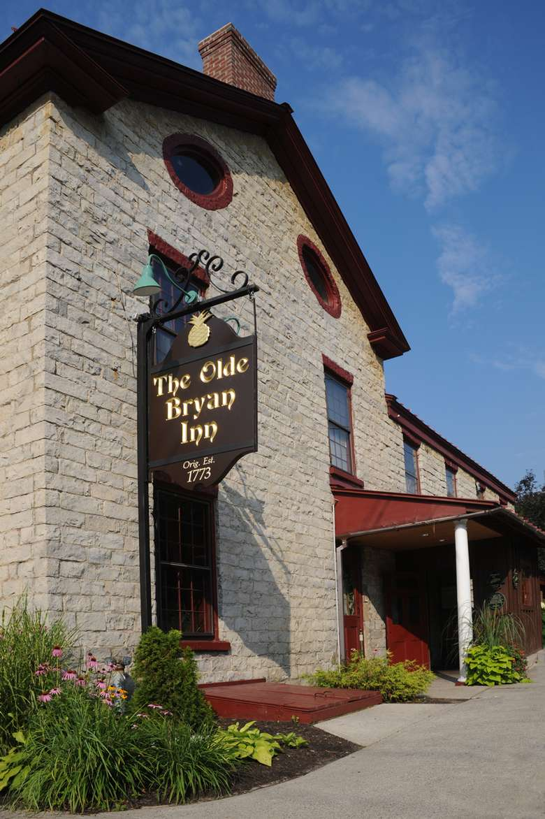 exterior of and sign for the olde bryan inn