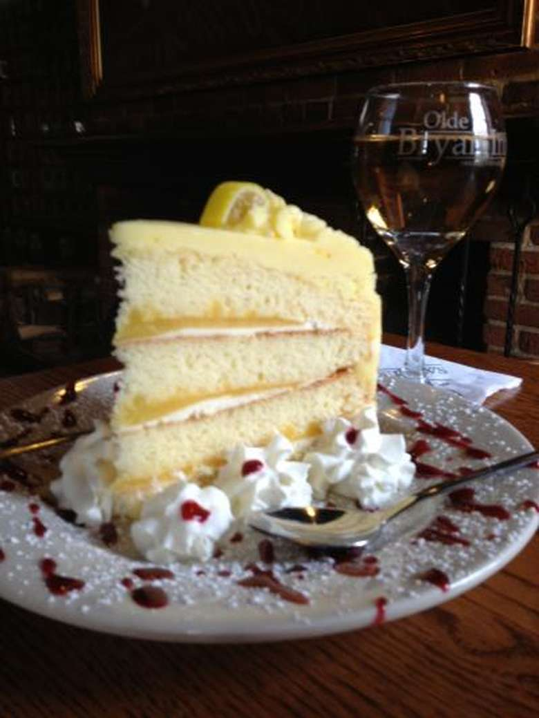 yellow cake with a glass of wine in the background