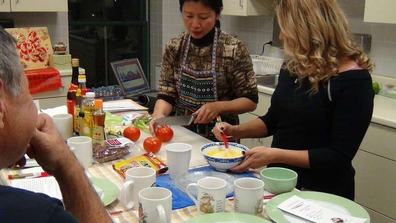 two women participating in a cooking class
