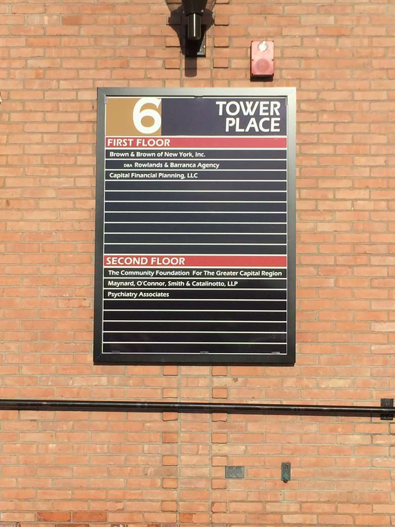 the building sign for 6 tower place