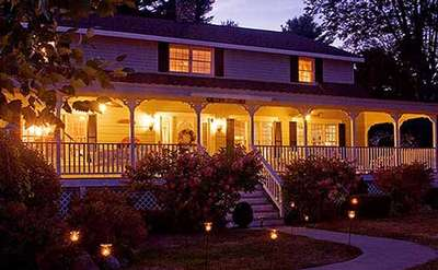 the bed and breakfast lit up at night