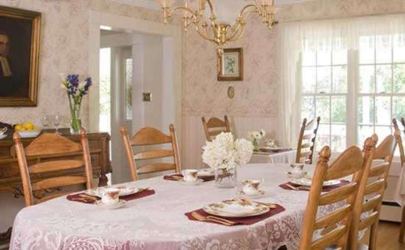 pristine looking dining area, wooden chairs