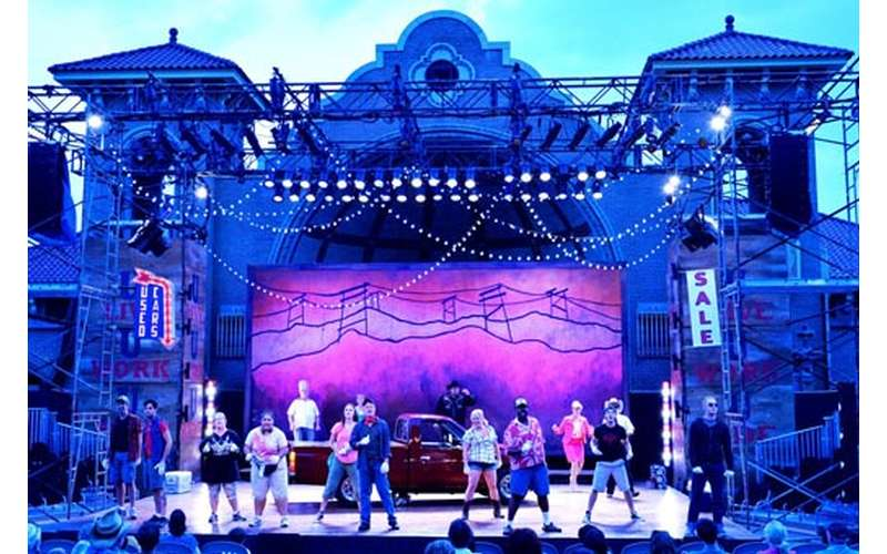 cast on outdoor stage