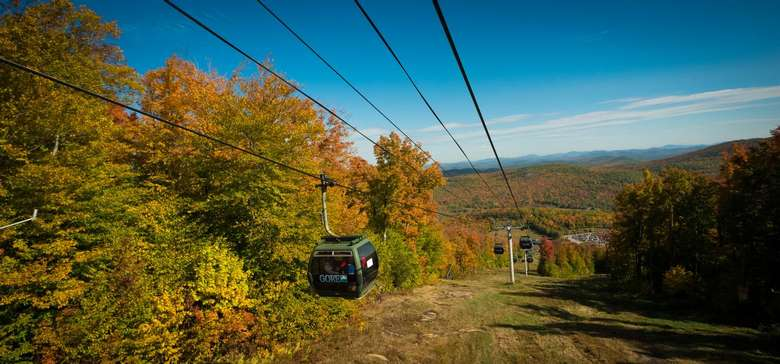 gore mountain gondolas surrounded by fall foliage