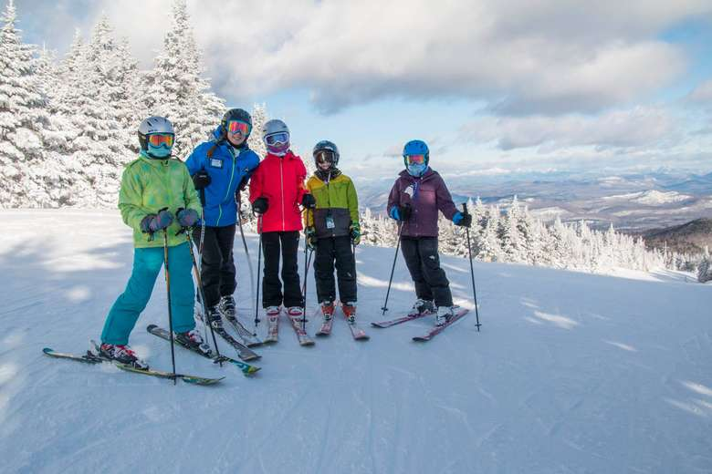 five skiers posing on a trail at gore mountain