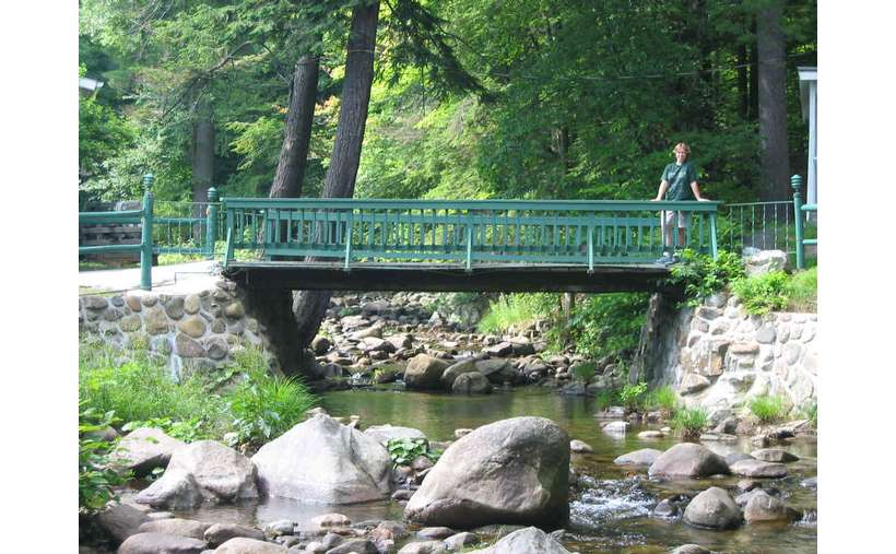 person standing a hiking bridge
