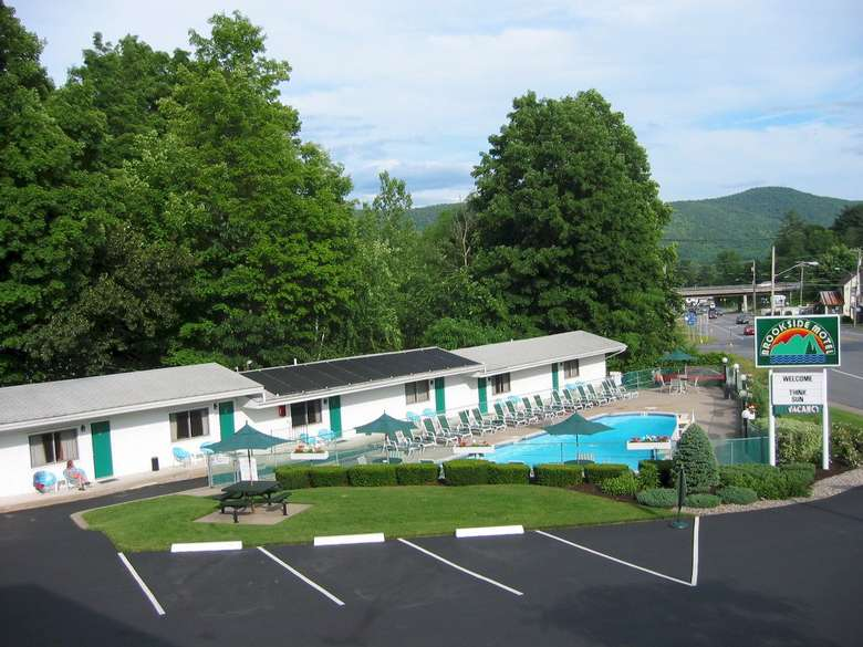 semi aerial view of motel, pool, parking lot