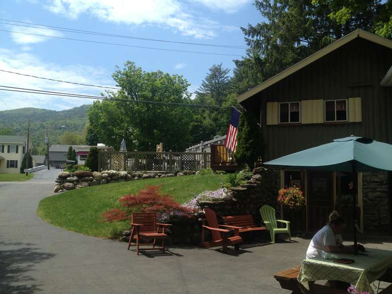 view of cottage from the side, area with picnic table and chairs