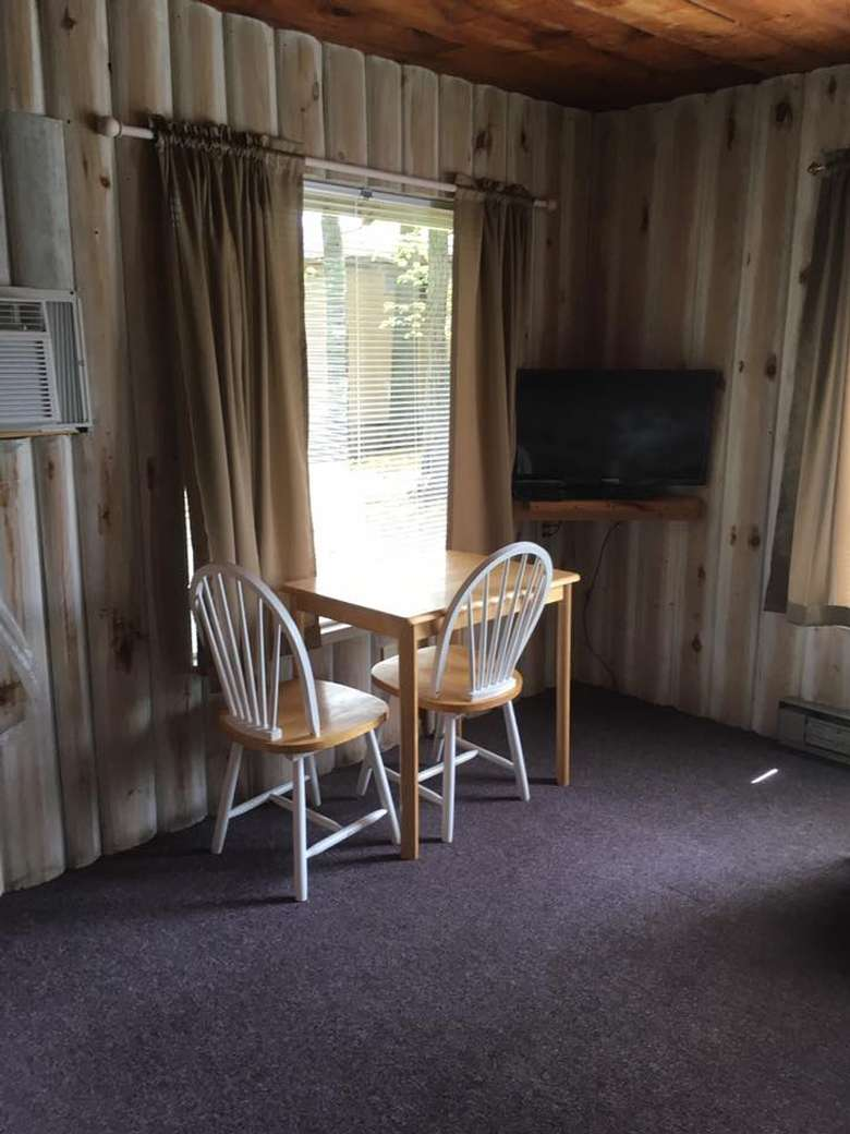 two chairs by a window and table