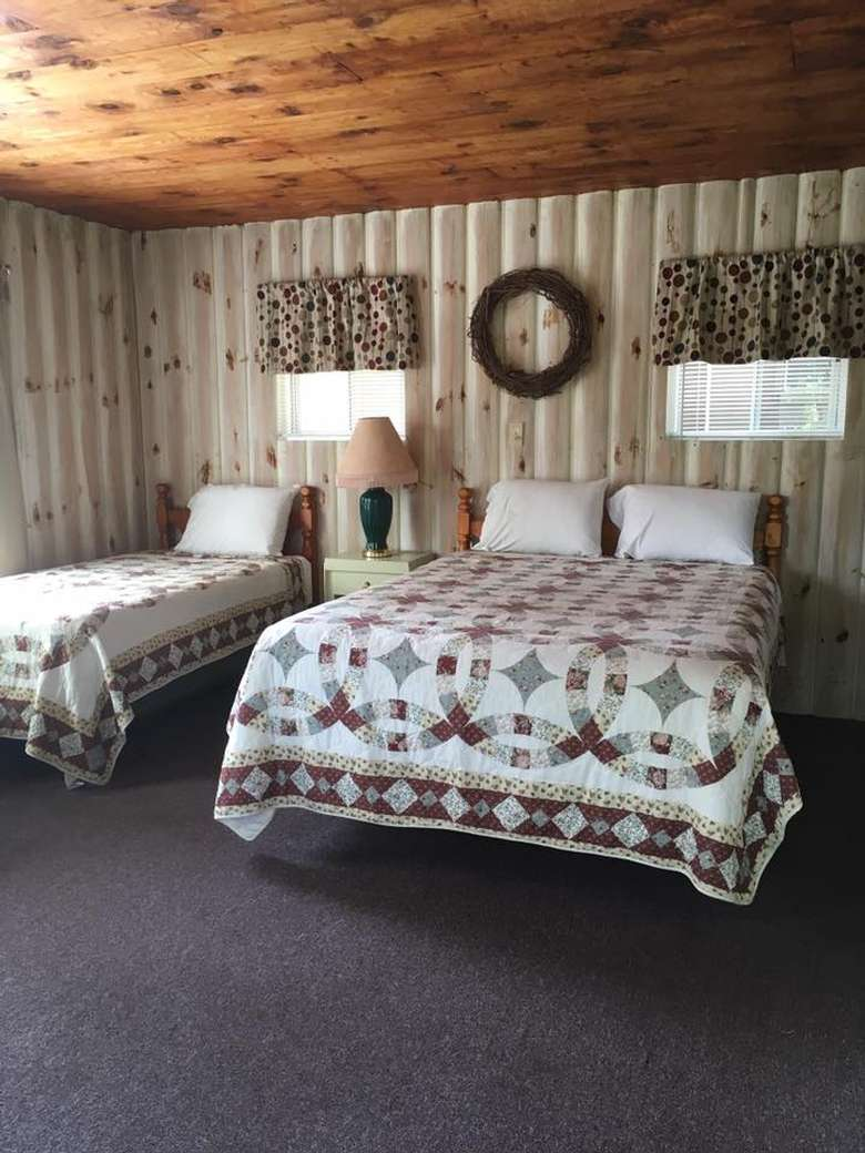 two beds side by side in a rustic room