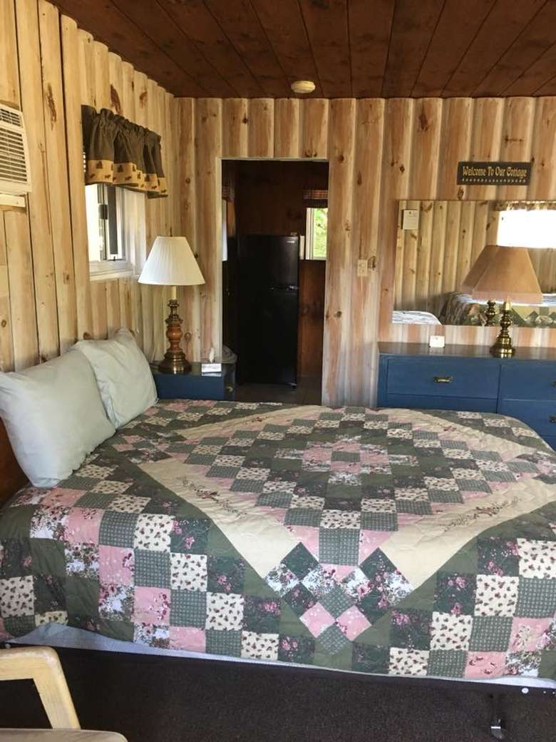 side view of bed in a cabin room