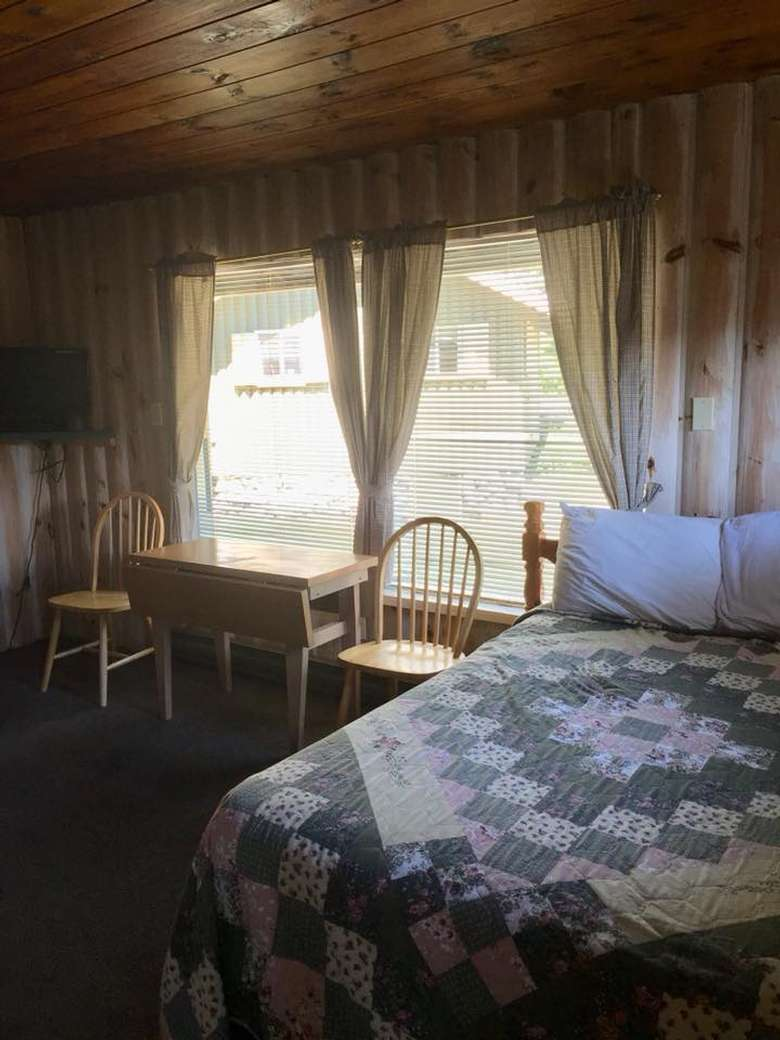 view of windows near a bed