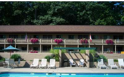 exterior of Tall Pines Motel with pool
