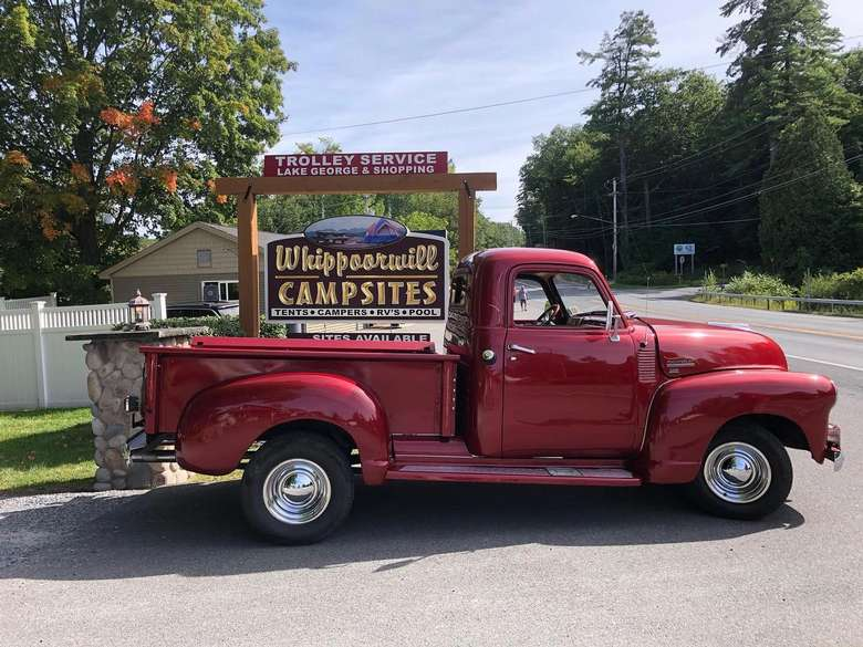 vintage truck in front of Whippoorwill Campsite sign