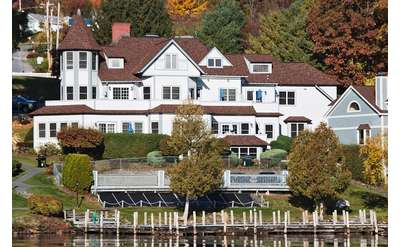 mansion and vacation units on the lake