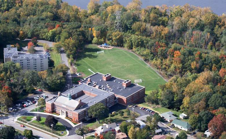 Aerial view of the school with a soccer field in the back