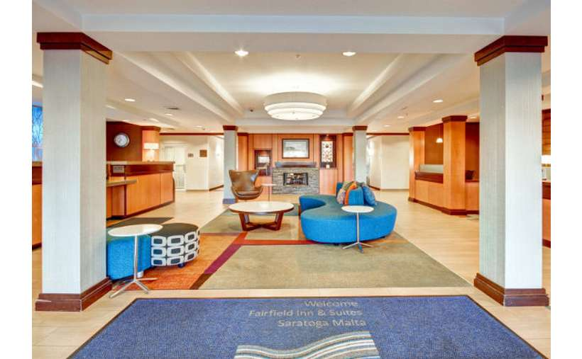 large lobby area of a fairfield inn and suites