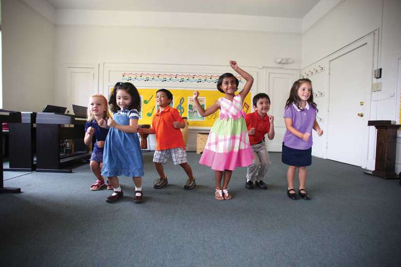 children dancing in a classroom