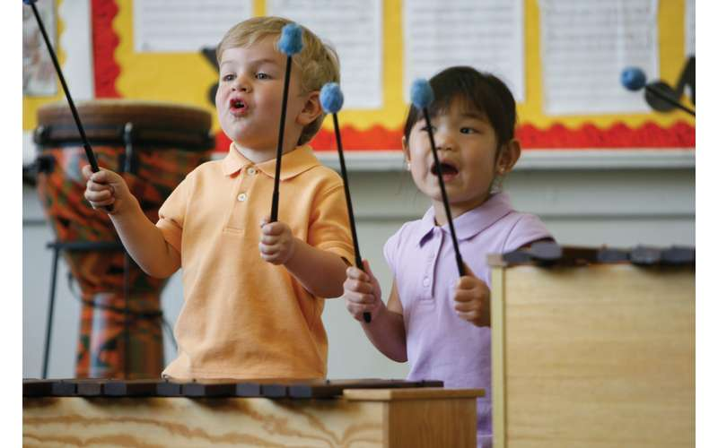 young students playing xylophone