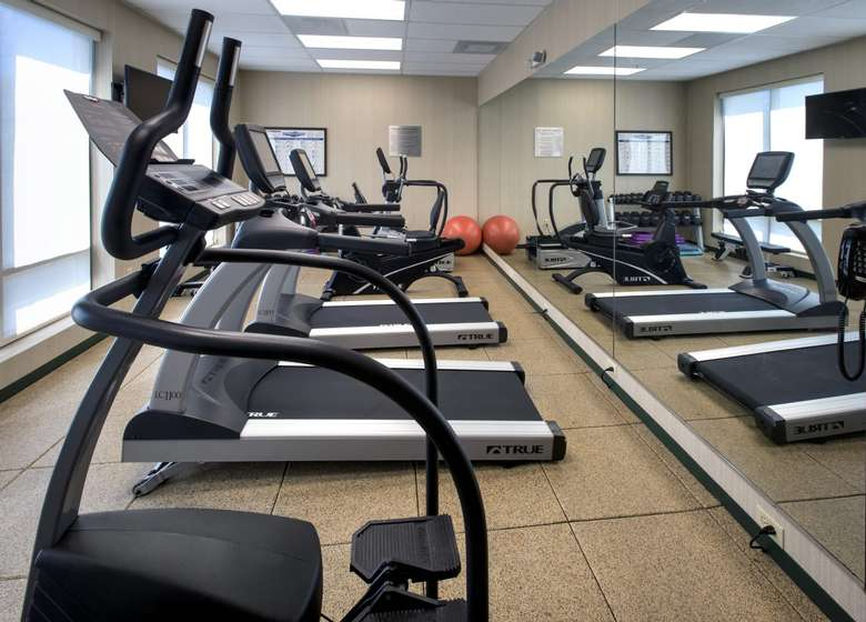 fitness center with treadmills and other machines