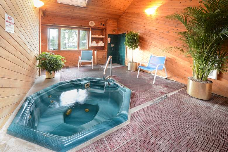 teal hot tub in a wooden room