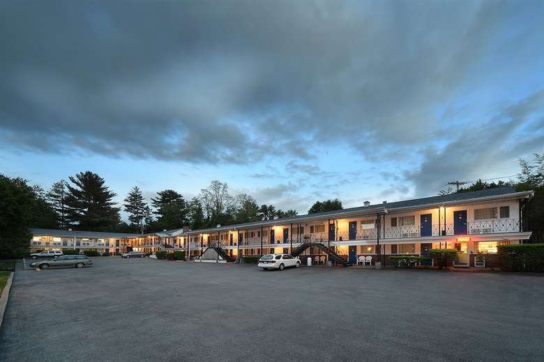 exterior of the two-story turf and spa motel at dusk