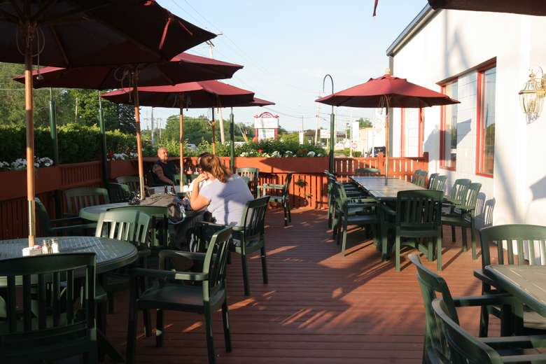 outdoor patio seating area with umbrellas at o'tooles