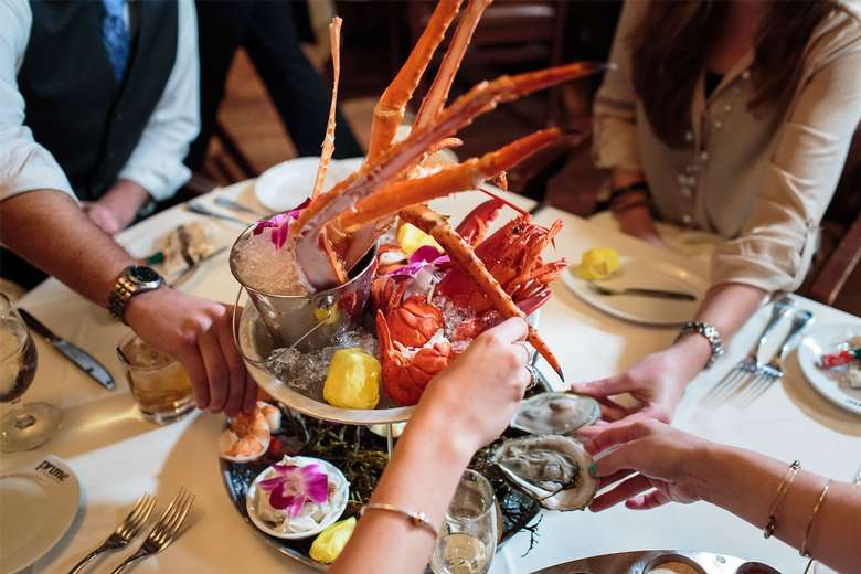 people sharing a seafood tower