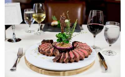 artfully plated steak with wine