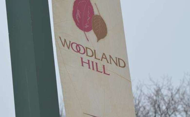 Woodland hill sign