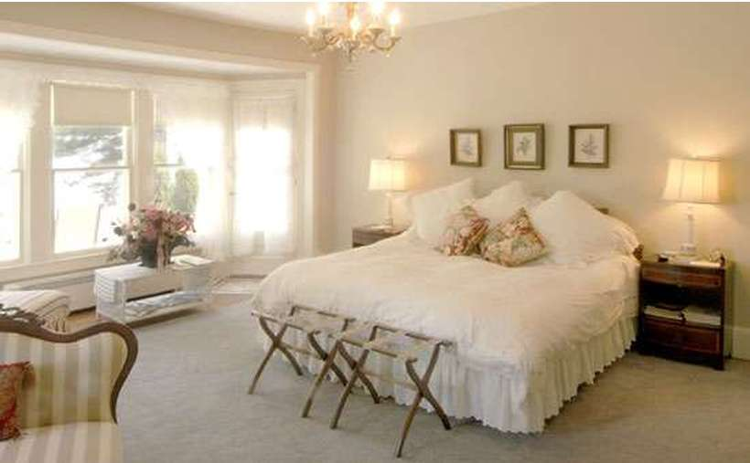 a very white and pristine bedroom