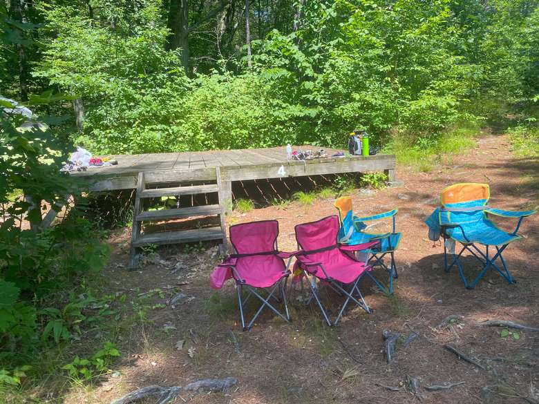 View of campsite 4 tent platform with chairs in front