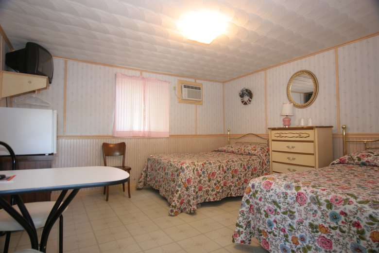 bedroom with two beds, floral blankets