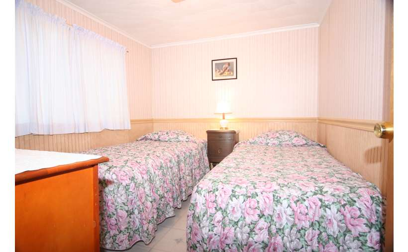bedroom with two beds with floral blankets