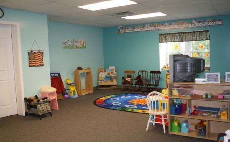 Play area in the daycare with alphabet rug