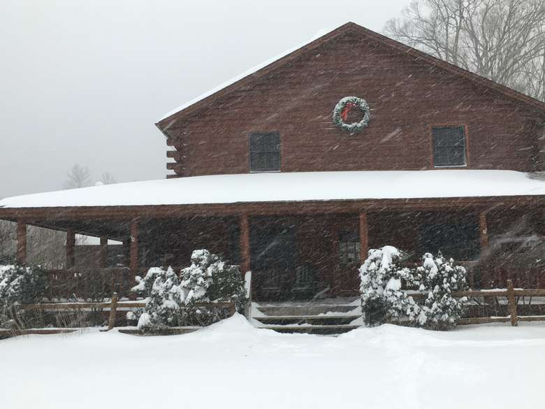 the lodge covered in snow