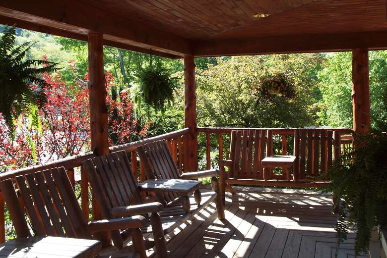 a wooden deck with chairs