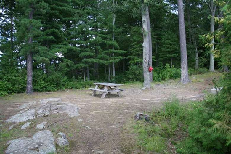 a picnic table located on the center of a flat area